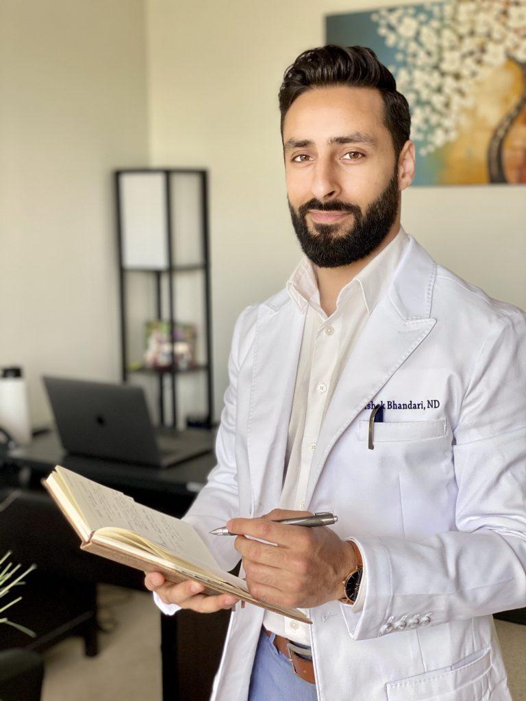 Dr. Ashok Bhandari with notebook